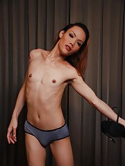 Skinny redheaded Asian tranny Joy baring flat chest and big hairy shecock